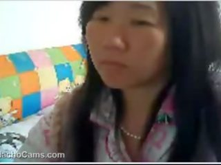 Full-blown Chinese Woman films Off Breasts
